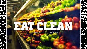 รูปผลไม้ วางอยู่บนชั้นหลายชั้น และมีตัวหนังสือเขียนว่า EAT CLEAN