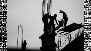 รูประกอบเป็นรูปกรรมกรก่อสร้าง กำลังสร้างอาคาร