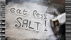 รูปเกลือโรยที่พื้นแล้วเขียนว่า eat less salt !
